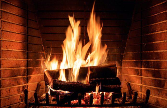 <p>log burning in a fireplace stock image</p><p>PHOTO COURTESY ADOBE STOCK</p>