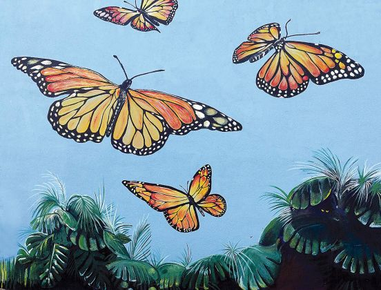 <p><p><strong>MONARCHS —</strong> The monarch butterfly mural, a portion of which is shown, is on the east wall of the building housing a Downtown DeLand Pizza Hut restaurant at 115 E. New York Ave. It was designed by DeLand artist Dr. John Wilton</p></p><p></p>