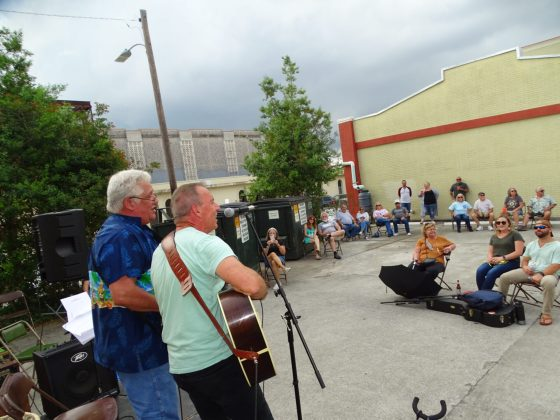 <p><p>Exit 44 band performs in Artisan Alley despite looming clouds</p></p><p></p>