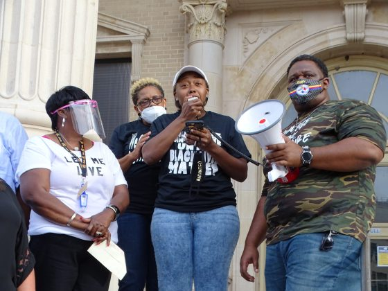 """<p><p>Organizer Andrea Mckinney reads from a <a href=""""https://www.beacononlinenews.com/opinion/andrea-mckinney-late-is-better-than-never/article_4e54f89c-a671-11ea-a862-a3541b5bb937.html"""" target=""""_blank"""">statement</a>.</p></p><p></p>"""