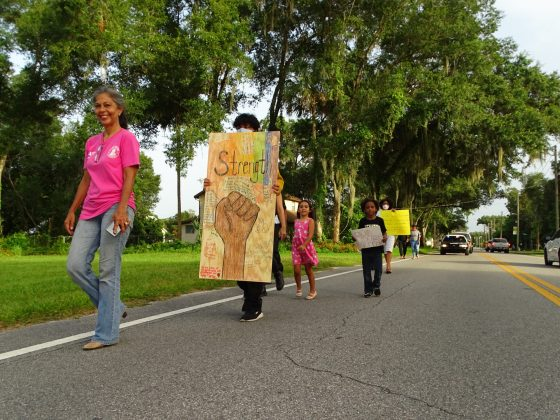 <p><p>Lake Helen Mayor Daisy Raisler, in front, marches with Lake Helenites to city                     hall June 26.</p>                 </p><p></p>