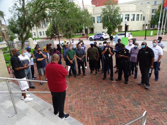 """<p><p>On Saturday, June 20, local Andre Darby, in red, <a href=""""https://www.beacononlinenews.com/news/amidst-racial-reckoning-west-volusia-celebrates-juneteenth/article_97e96e68-b173-11ea-959b-cfbf53ac926c.html""""                     target=""""_blank"""">organized a morning stand against injustice</a>.</p>                 </p><p></p>"""