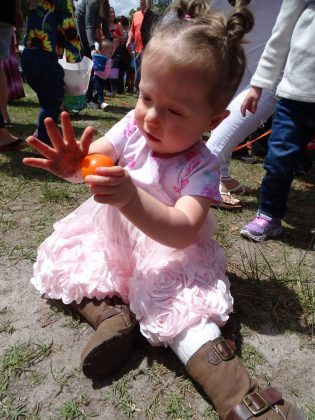 <p><p>Alexandra Ledford seems satisfied with her find at Lake Helen's egg hunt</p></p><p></p>