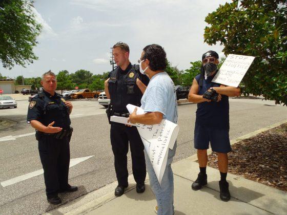<p><p>Antonio Tovar, center, with members of the DeLand Police Department, at left.</p></p><p></p>