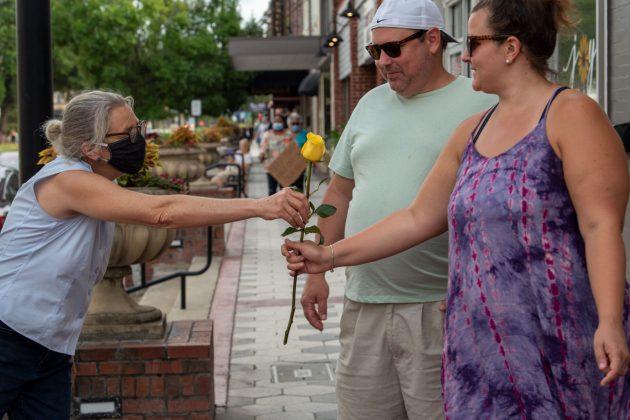 <p><p><em>The Beacon</em>publisher Barb Shepherd passes out roses to protestors June 2.</p></p><p>THE CANOVAS PHOTOGRAPHY</p>
