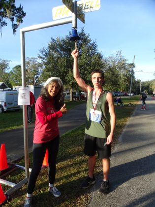 <p><p><strong>TOP FINISHERS</strong>— Lake Helen Mayor Daisy Raisler congratulates Joshua Webster on his time of 20 minutes, 48.2 seconds. According to the race website, Josh Ebert beat Webster by about 5 seconds to take first place overall.</p></p><p>BEACON PHOTO/MARSHA MCLAUGHLIN</p>