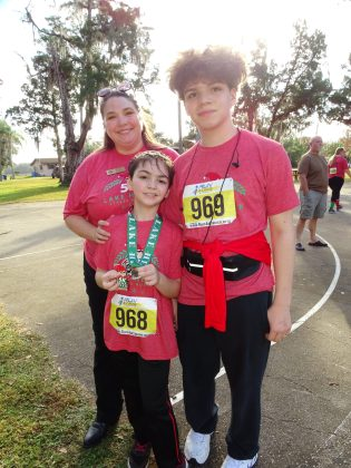 <p><p><strong>IN ON THE ACTION</strong>— Lake Helen City Commissioner Kelly Frasca congratulates her children, Giovanni Frasca and Joaquin Frasca, on cmpleting the Lake Helen Stress Buster 5K on Christmas Eve.</p></p><p>BEACON PHOTO/MARSHA MCLAUGHLIN</p>