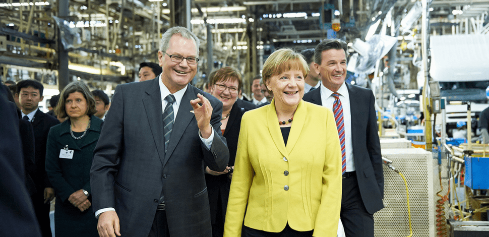 Daimler's Dr. Albert Kirchmann with Angela Merkel