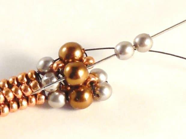 Learn to make the delicate Mixed Metals Bracelet using Tubular Herringbone Stitch.