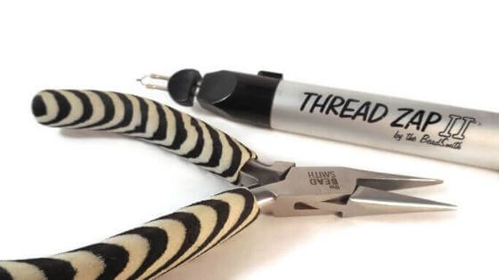 Chain nose pliers and a Thread Zap II