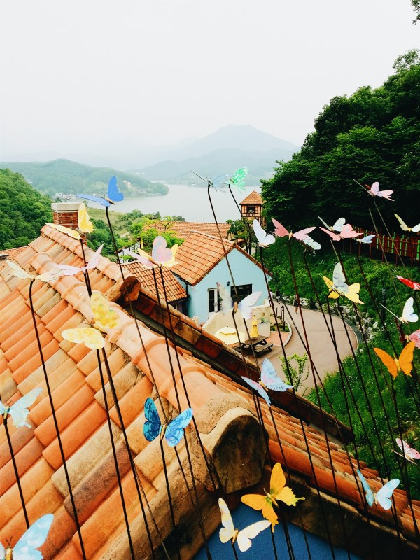 Paper Butterflies decorated above the brick roof
