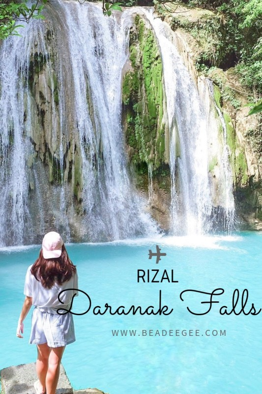 A girl standing on her back with Daranak Falls Tanay in her background