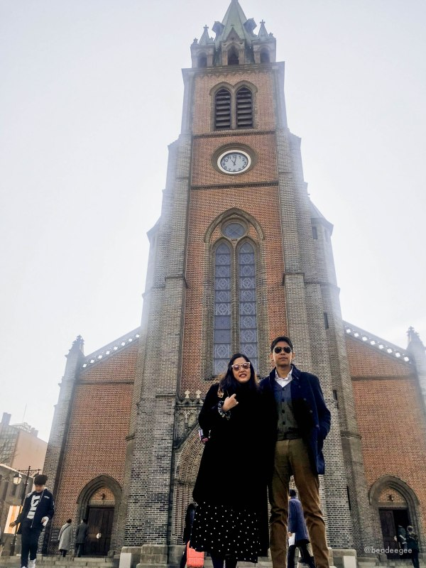 A couple in front of Myeongdong church in Seoul