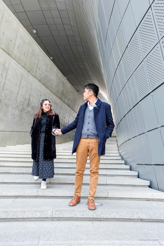 Couple going down the stairs in Dongdaemun Design Plaza in Seoul