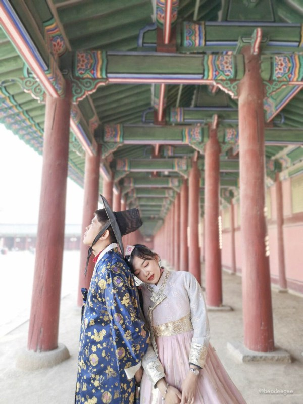Couple wearing traditional Korean Hanbok in a palace
