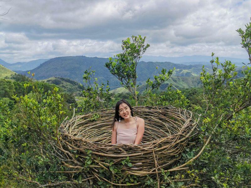 a girl inside a Bali-inspired nest in El Patio Razon