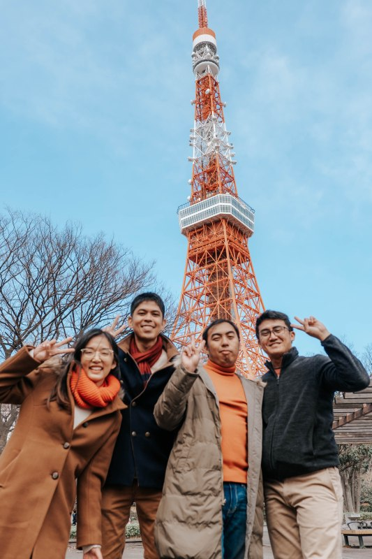 1 girl and 3 boys in front of Tokyo Tower