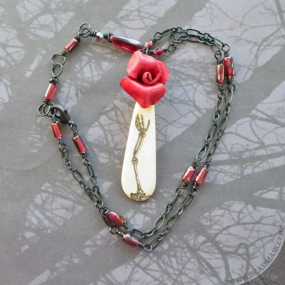 leather rose and skeleton pendant