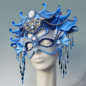 sculpted leather mask and headpiece, embellished with hand sewn beadwork with Swarovski crystals and vintage glass cabochons