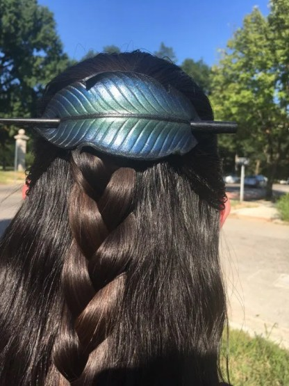Leather raven feather barrette being worn