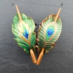 leather peacock feather shawl pins in emerald (A) and olive )B) green
