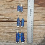 Leather blue jay feathers with sterling silver wirework