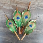 leather peacock feather hair slides