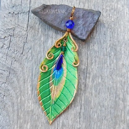 peacock feather leather pendant