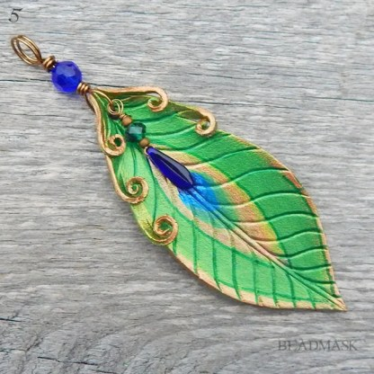 leather peacock feather pendant
