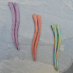Wavy wooden hairsticks in colorful striped birch laminate