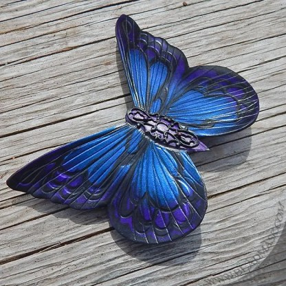 leather butterfly barrette in purple and blue