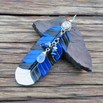 leather blue jay feather pendant