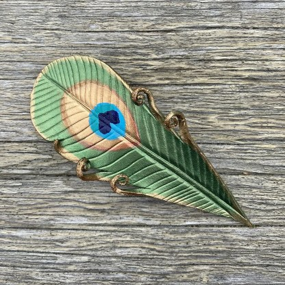 leather peacock feather barrette