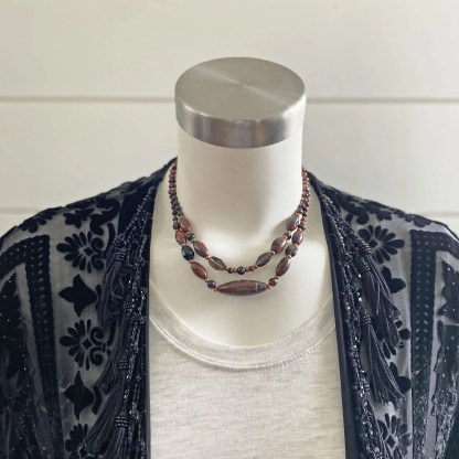 gemstone layering necklaces in deep reds