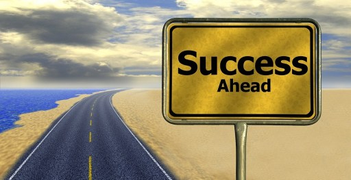 road sign that says Success Ahead
