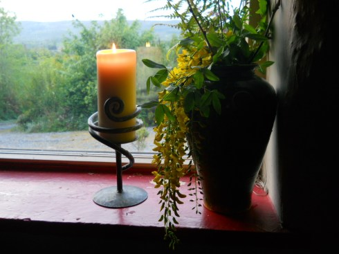candle in the window at  Bealtaine cottage