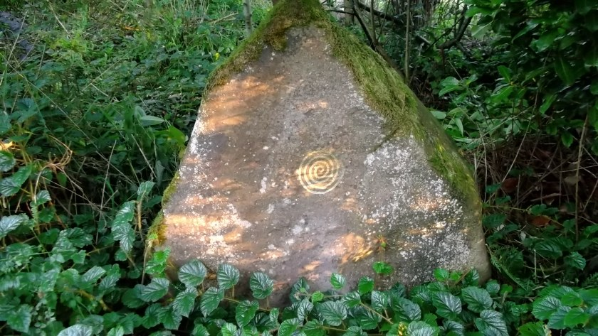 Bealtaine Cottage standing stone in permaculture gardens