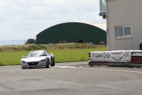 Simon Hutchings coming around the Bus Stop in his VX220