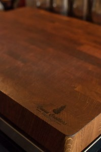 Custom white oak butcher blocks for The Oxbow Natural Wine Bar & Restaurant (close-up of BeardBrothers WoodWorking logo)