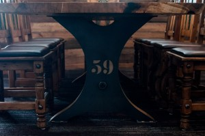 Close-up of custom steel base for Junction 59 Roadhouse table