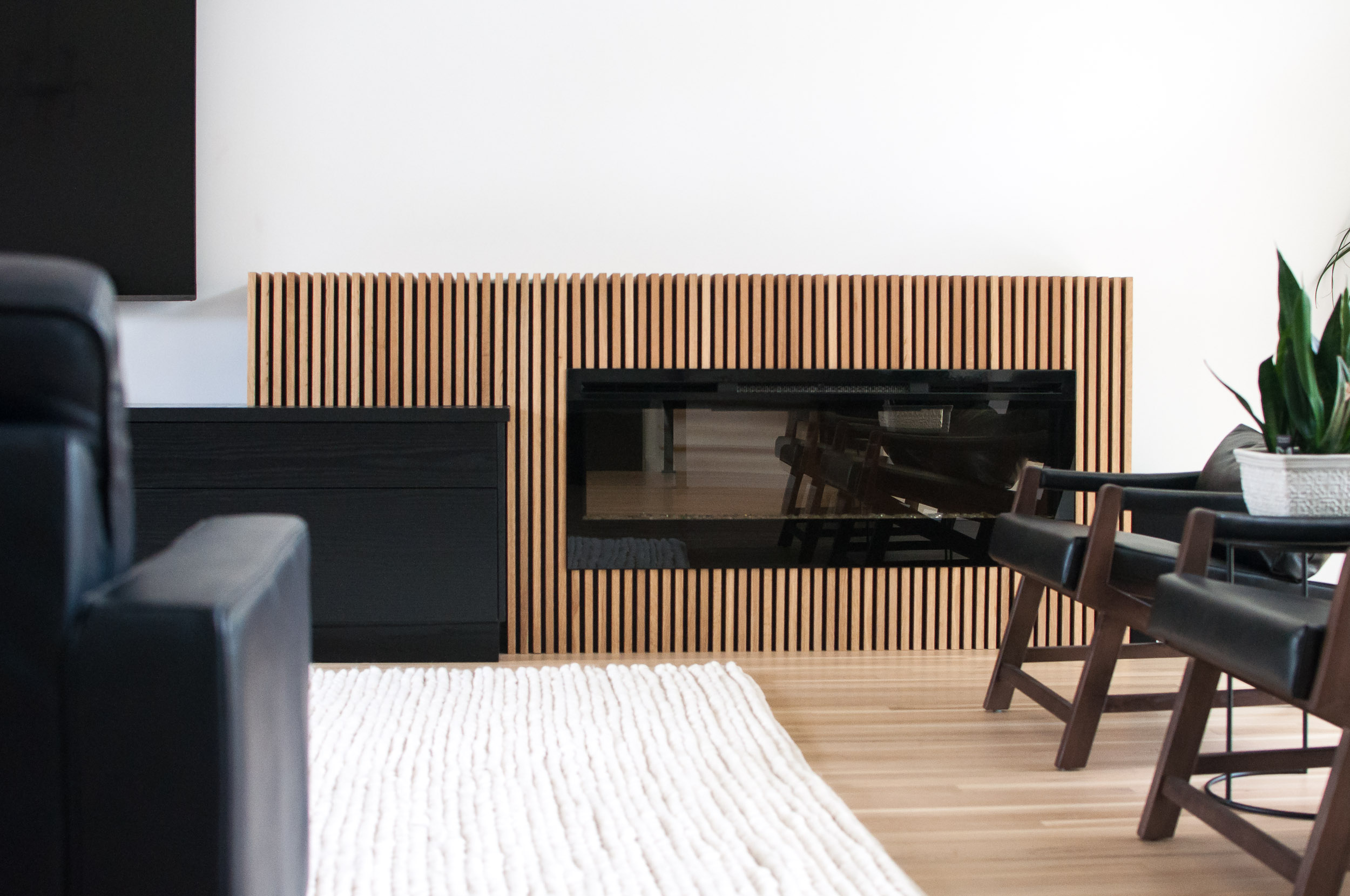 Full-Width Shot of Custom White Oak Slats for Electric Fireplace in River Heights home in Winnipeg