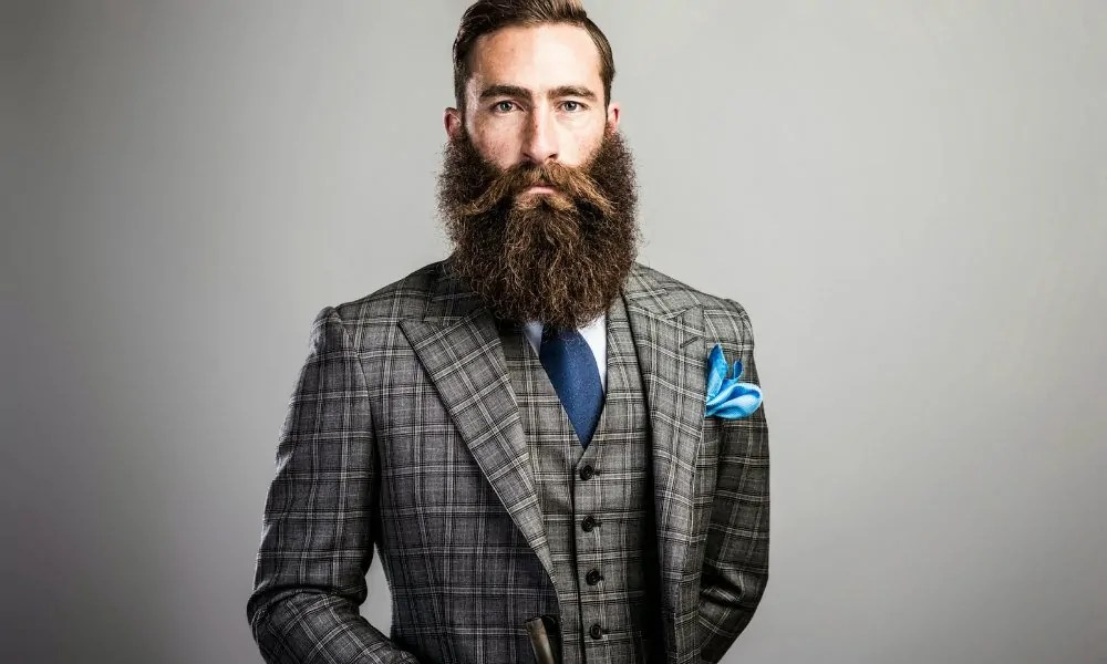 How To Properly Wear A Suit While Sporting Facial Hair