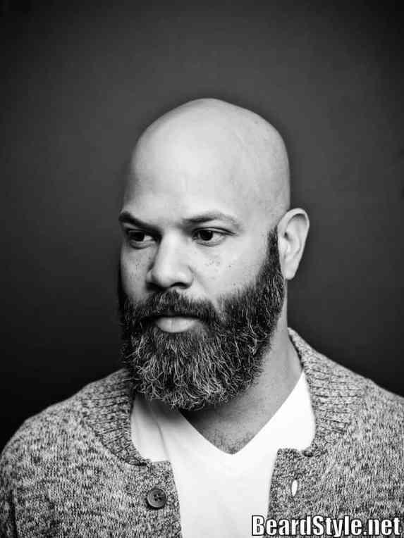 a-man-with-bald-head-and-long-beard