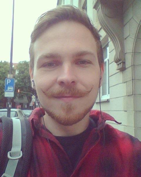 curly handlebar mustache for boy