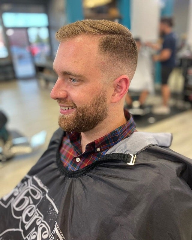 bald fade with part and beard