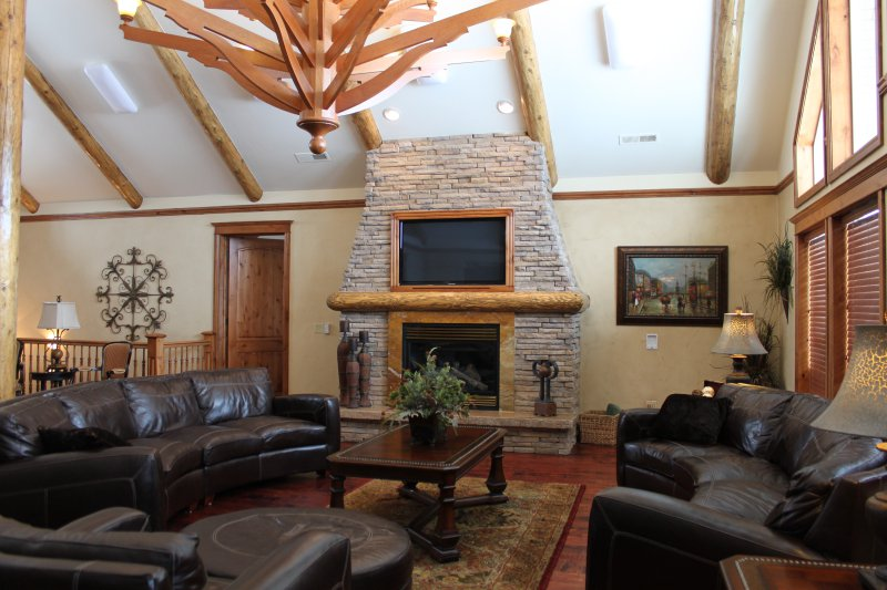 Great Room with open stairway to family room