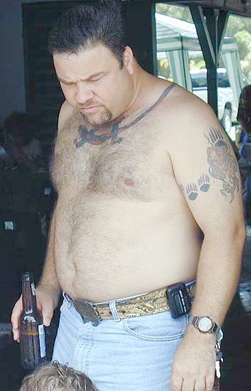 shirtless-bear-with-beer-and-beeper