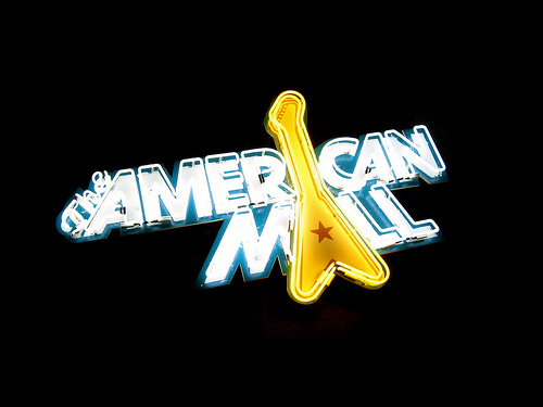 """""""The American Mall"""" neon sign over the bar"""