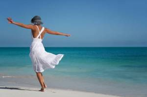 Woman-Dancing-On-Beach