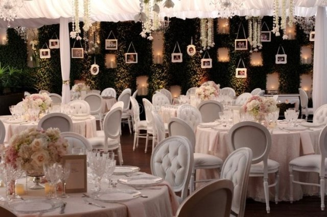 The main dining room decorated in white for a wedding held at Ristorante Beatrice.
